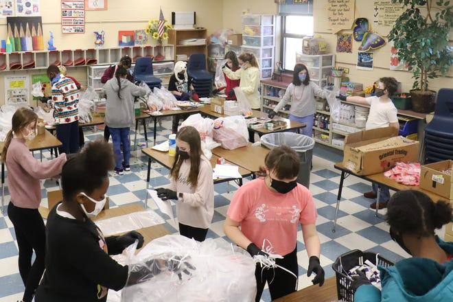 Registration for new students and kindergarten students in the Fort Smith Public School District in the 2021-2022 school year will begin Monday, April 5, 2021. Fairview Elementary School sixth-grade students are seen here making gift bags for Fairview's 15th Christmas in a Bag Project.