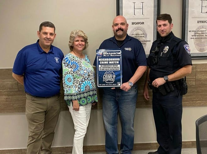 Ellis County Crime Stoppers members from Waxahachie PD are (from left): Assistant Chief Wiser, Shari Phillips (CSEC Exec. Chair), Officer O.T. Glidewell and Officer Greg Brister