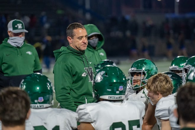Waxahachie head football coach Todd Alexander speaks to his team at the end of Friday night's Class 6A Division II bi-district playoff game at Temple's Wildcat Stadium. Temple beat the Indians, 38-0.