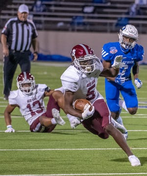 Red Oak receiver Kentrell Anderson (5) makes a move during a game last month in Midlothian. Anderson scored on a 94-yard play on Friday night as the Hawks routed Justin Northwest, 62-7, in the bi-district round of the Class 5A Division I playoffs.