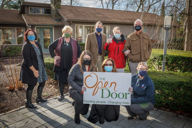Julie LaFontaine and Sarah Grow from The Open Door present Dick Wilson with The Open Door Dick Wilson Upsizer Award in a socially distant presentation along with members of Beauport Financial Services.