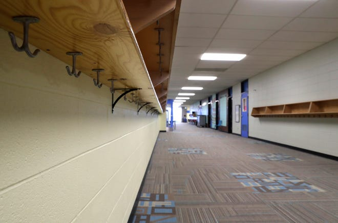 A McKinley Elementary School hallway that's usually bustling with students, teachers and school staff stands empty Thursday, Dec. 3. The district is setting its sights on bringing students back to classrooms at least part-time in the new year.