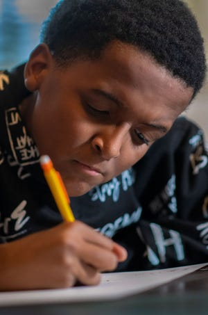 Jamel Taylor, 10, of Bond Hill, has a serious vision impairment that requires special glasses and other adaptive devices to help him see.