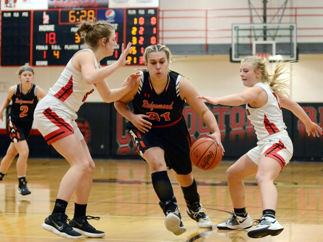 Kelsie Stephens drives into the lane for two of her career-high 27 points in Ridgewood's 52-27 win against host Coshocton on Monday night at The Wigwam.