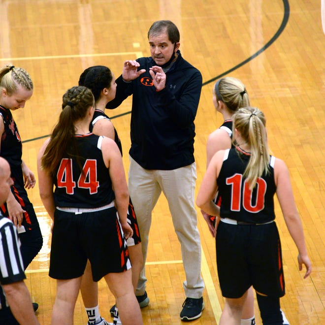 Ridgewood coach Scott Bardall talks to the team during a timeout in the second half in a game with Coshocton earlier this season. The Ridgewood girls, like many area teams, recently experienced quarantine due to COVID-19 protocols.