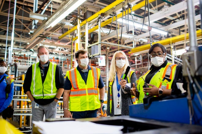 (Left to right) Ford engineering specialist Shaunise Williams, Gary Johnson, CEO Jim Farley, Dearborn Truck Plant Manager Debbie Manzano and launch team member Edana Jones discuss a machine operation on September 25, 2020. Johnson, chief manufacturing and labor affairs officer, will retire on February 1, 2021.
