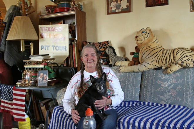 Diane Schindorff and her dog Buddy relax in their living room on Castalia Street in Fremont.