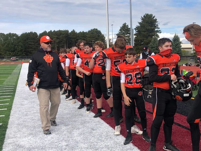 More than $10,000 has been raised to cover the medical expenses of Jason Estronza (left), a Brighton youth football league coach who had surgery for oral cancer.