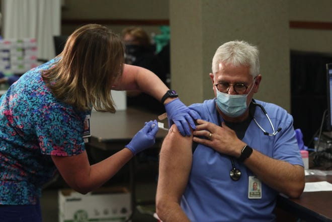 Dr. William Moss became the first person at the Medical Center in Bowling Green to receive a COVID-19 vaccination Monday, Dec. 14, 2020.