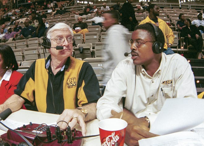 Jerry Bartley and Anthony Fleming calling the plays at a basketball game in the Acadome.