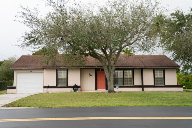 A home next door to Naples High School, photographed on Monday, Dec. 14, 2020, would be bought by the Collier County School District to expand services for students with disabilities.