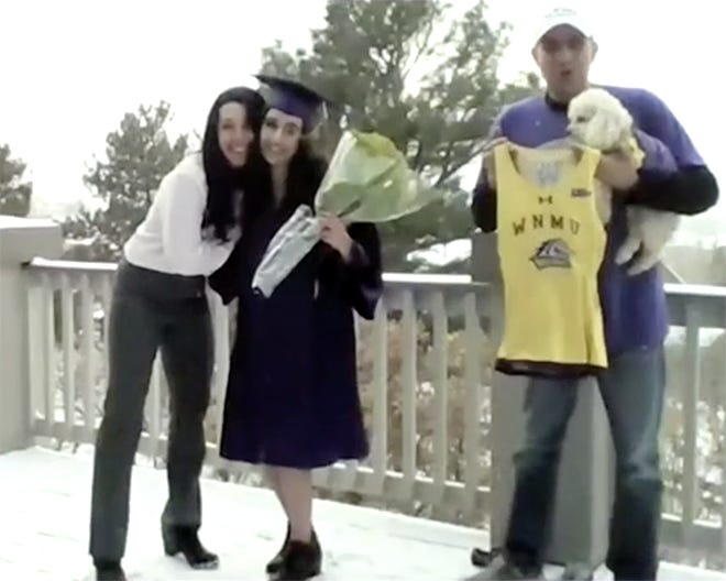 Western New Mexico University fall 2020 graduate Kayla Noriega (pictured center), who earned a Bachelor of Science in cell and molecular biology, chose to participate in the live virtual commencement ceremony from a snowy deck.