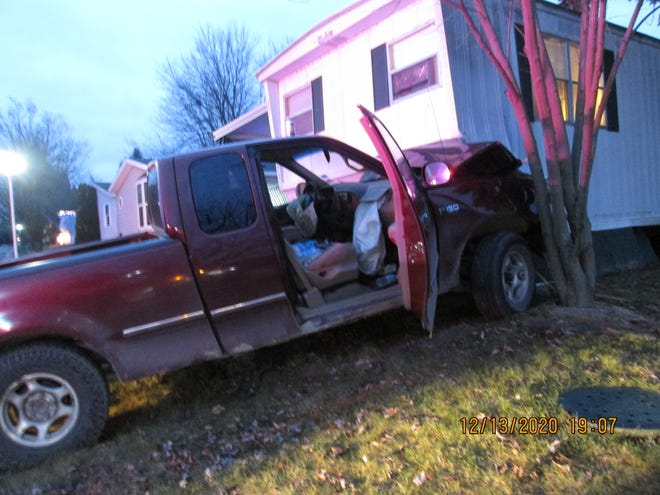 A Ford F-150 truck struck a Lyon Township mobile home on Sunday, Dec. 13, 2020.