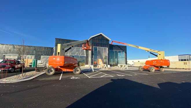 Construction crews work on building Bergstrom Automotive's body shop and collision center.