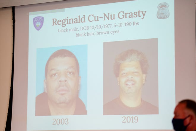 Mugshots of Reginald Cu-Nu Grasty are displayed during a press conference regarding Tuesday, Dec. 15, 2020, regarding a body found on the USNSCS Grayfox in June. Reginald Cu-Nu Grasty has been named a suspect in the murder, and a warrant has been issued for his arrest.