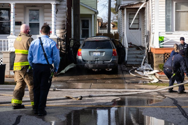 Crews responded to a vehicle fire in the 1000 block of Erie Street Tuesday, Dec. 15, 2020, in Port Huron. The fire caused minor damage to the exterior of a nearby home.