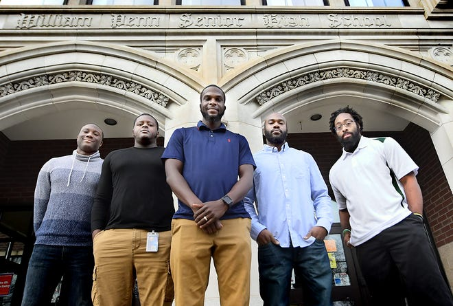 A group of York-area men, who are planning a youth-building nonprofit, pose outside William Penn High School Monday, Dec. 14, 2020. They are, from left, Brandon Parker, Da'Vaughn White, Tavon Parker, Jordan Boatwright and LaQuinn Thompson. The five board members are launching the Advantage Program next June. Three of the men –Da'Vaughn, Brandon and Tavon – are William Penn High School graduates. Bill Kalina photo