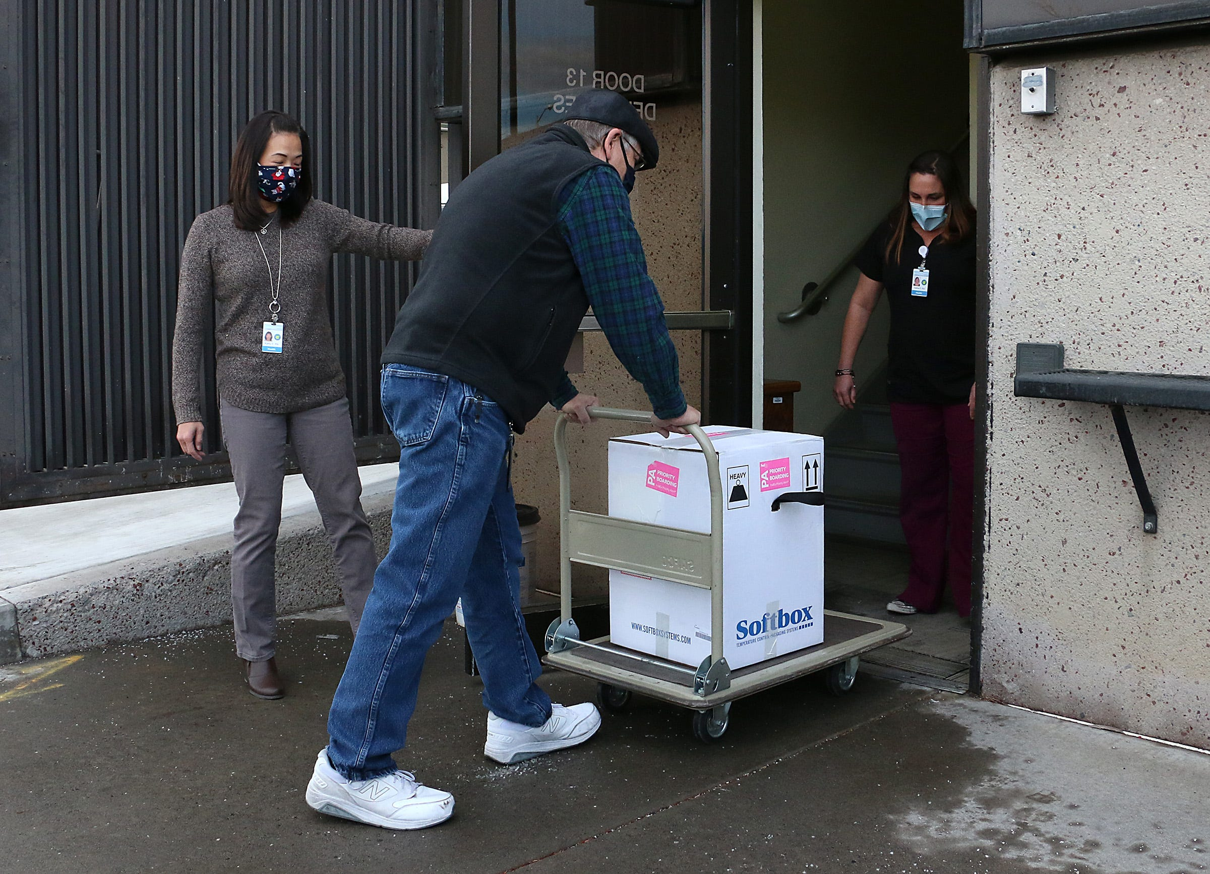 Washoe County Health District employee Michael White brings the newly arrived Covid vaccine into the county building in Reno on Dec. 15, 2020.