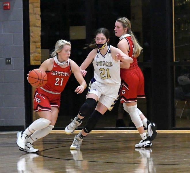Christoval High School's Kallie Montalvo (21) dribbles the ball while San Saba's Landri Glover defends during a high school girls basketball game Tuesday, Dec. 1, 2020, at San Saba High School.
