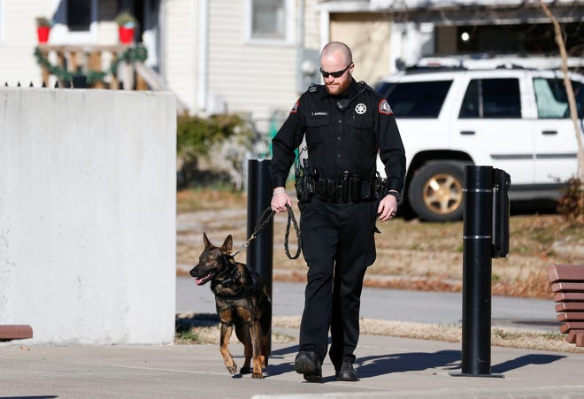 Greene County Sheriff's Deputy Tyler Marshall takes his K9 partner Rocky on a walk outside the Greene County Emergency Operations Center on Dec. 9.