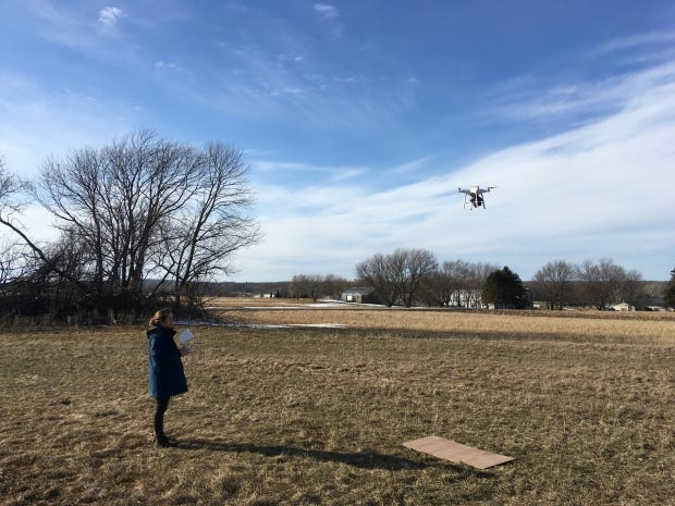 Grace Graham, a licensed drone operator, works with the Wisconsin Geological and Natural History Survey to obtain temperature data of fields using a drone.