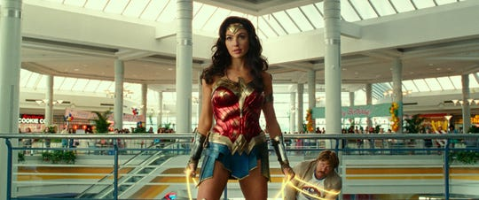 "Wonder Woman (Gal Gadot) takes out a crew of bad guys and foils a jewelry heist at a mall in ""Wonder Woman 1984."""