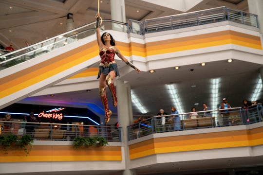 "Even in a mall, Wonder Woman (Gal Gadot) swoops down to save the day during a heist sequence in ""Wonder Woman 1984."""