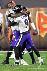 Kicker Justin Tucker of the Ravens celebrates with Lamar Jackson after making a go-ahead field goal during the fourth quarter in the game against the Browns Monday night.