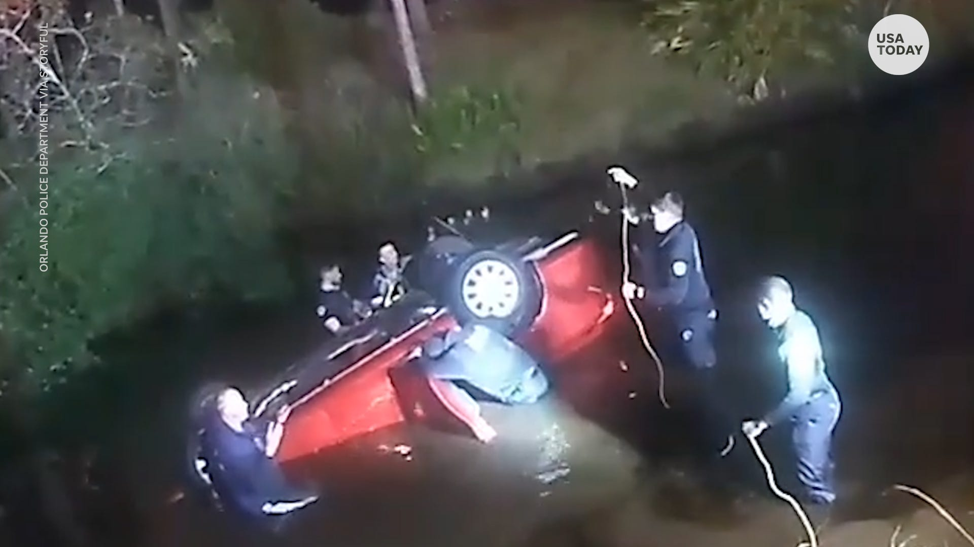 Orlando police and firefighters save family trapped in their car that landed in a pond