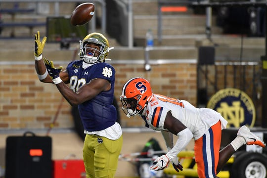 Notre Dame's wide successor Yavon McKinley catches a touchdown pass in front of Syracuse corner Gareth Williams during his game at Notre Dame Stadium.