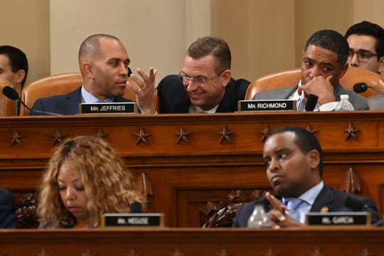 Rep. Doug Collins, R-GA, center, speaks with Rep. Hakeem Jeffries, D-N.Y. during the House Judiciary Committee markup of the impeachment articles against President Donald J. Trump.
