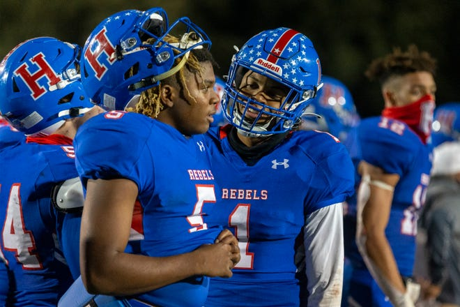 Hays quarterback Durand Hill, celebrating a victory over Bowie with receiver Bryant Lewis last month, accounted for 290 yards in last week's bidistrict victory over Vista Ridge.