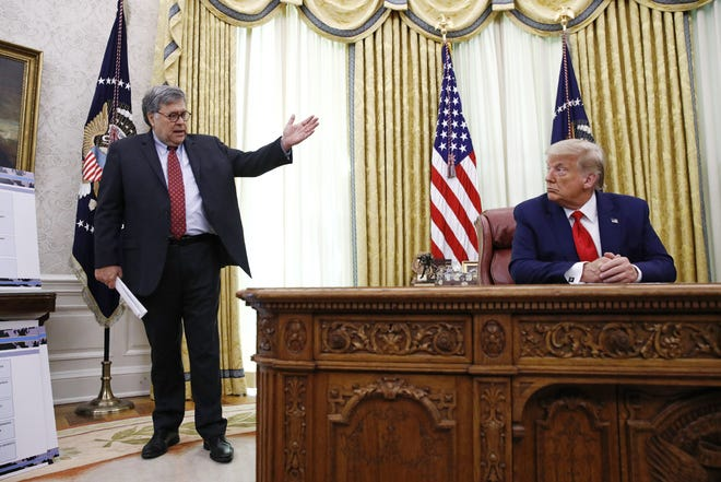 In this July 15, 2020 file photo, then-Attorney General William Barr  speaks with President Donald Trump in the White House. [AP PHOTO/PATRICK SEMANSKY]