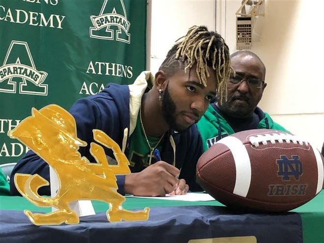 Deion Colzie signs with Notre Dame on Dec. 16, 2020.