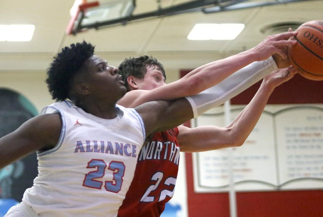Alliance's Brandon Alexander, left, and Northwest's Alex Goddard going for a loose ball during action at Alliance High School Tuesday, December 15, 2020.
