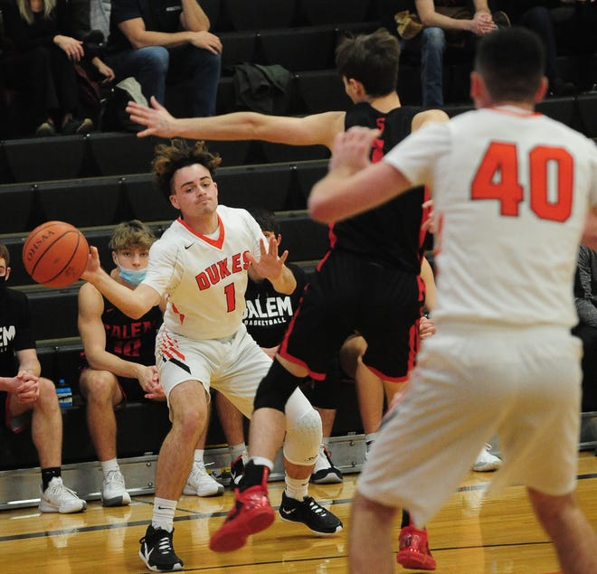 Marlington's Macagey Laure passes to teammate Tommy Hippely (40) in an Eastern Buckeye Conference game against Salem at Marlington High School Tuesday, December 15, 2020.