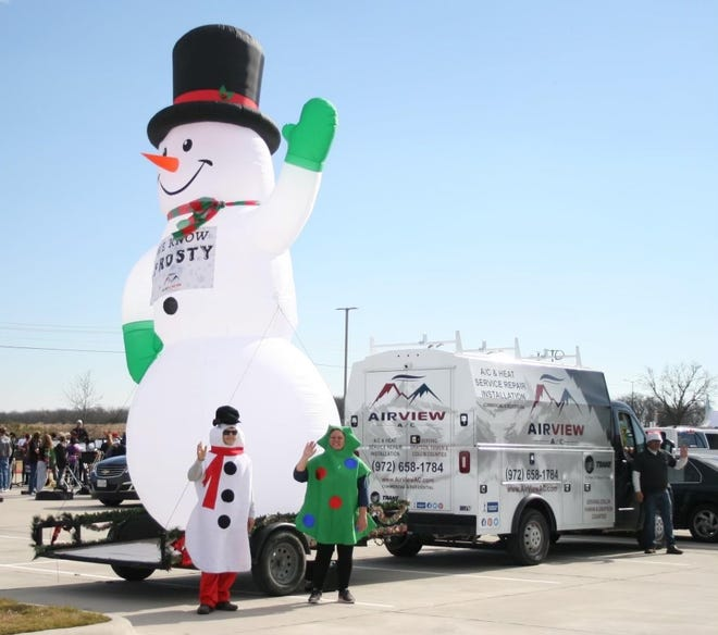 "Sunny skies prevailed during Anna's Dec. 12 reverse Christmas parade.  It may have been too warm for a real snowman, but the inflatable variety were doing just fine at Judith L. Harlow Elementary. Among other special guests were visitors from the film ""Frozen"" and the Anna Fire Departments.  Smiles were in abundance all afternoon."