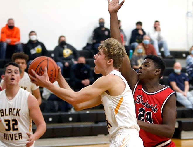 Black River's Logan Clifford (13) drives in for a shot against Brookside's Elijah Sheffield (24) during BR's 60-57 win Tuesday night at Black River High School.
