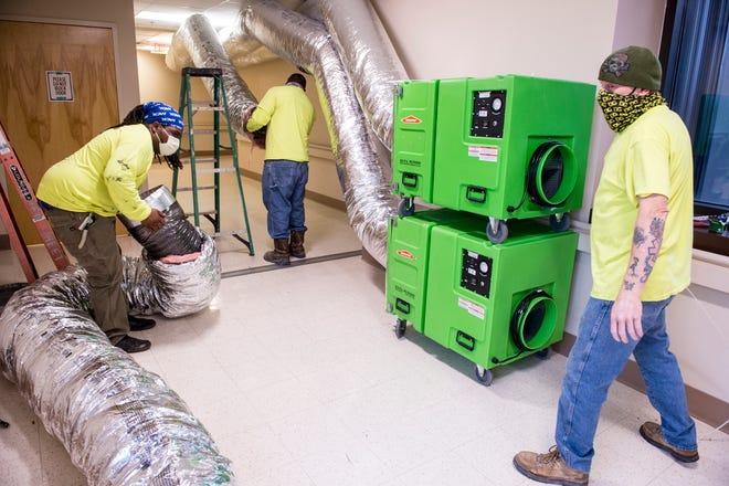 Workers install ventilation equipment in what will become another COVID-19 unit at University hospital in Augusta, Ga., Wednesday afternoon, December 16, 2020.