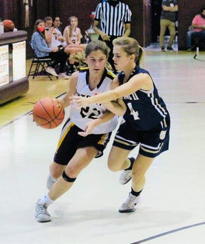 PHA's Harper Rice drives the ball down the court.