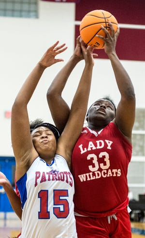 Laney's Alteona Collier, right, tires to get a shot past Westside's A'Mya Brooks during basketball action at Westside High School in Augusta, Ga., Tuesday evening, December 15, 2020.