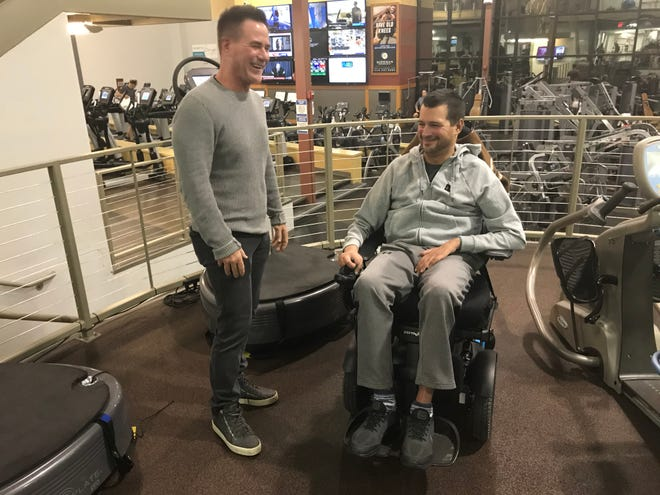 In this December 2019 photo, Newtown Athletic Center owner Jim Worthington shares a laugh with client Matt Bellina, of Holland, a former Navy jet fighter pilot with ALS. Worthington will not close his fitness center, despite COVID orders by Gov. Wolf to do so.