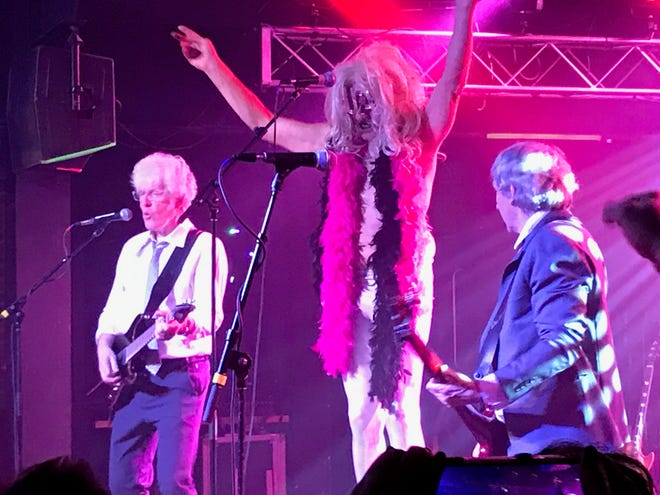 Fee Waybill, in 12-inch heels, towers over his Tubes bandmates as he portrays his glam-rock and wrecked character Quay Lude at Jergel's Rhythm Grille this past January.