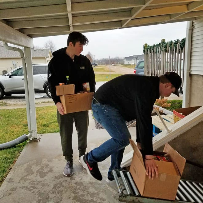 Prairie Home senior members of Beta Club Luke Stewart and Colton Searles deliver food Dec. 11 to the Mustard Seed Food Pantry. This was the third year the school has had a holiday food drive for the local pantry.