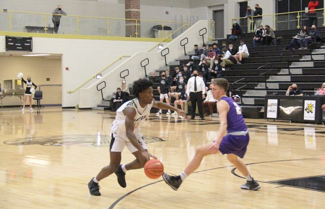 Andover Central's Brian Perry (left) drives by Valley Center's Eli Isaacs (right) on Tuesday, Dec. 15 at Andover Central High School in Andover, Kansas. Perry finished with a team high of 17 points in the 68-61 loss to Valley Center.