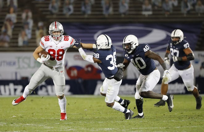 Ohio State tight end Jeremy Ruckert, here heading upfield after making a catch against Penn State, has accepted his primary role as a blocker in the Buckeyes' multifaceted offense.
