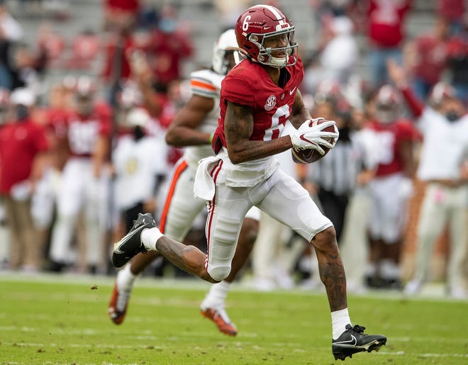 Alabama wide receiver DeVonta Smith (6) runs for a touchdown after a reception against Auburn during a game Nov. 28 in Tuscaloosa, Ala.