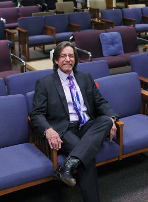 Tom Shields, who will retire Jan. 29 after 37 years as Franklin County Municipal Court jury commissioner, sits in an empty jury assembly room on the ninth floor of the courthouse. The end is bittersweet because jurors are on call during the pandemic and come to the courthouse only for the rare trials being held.