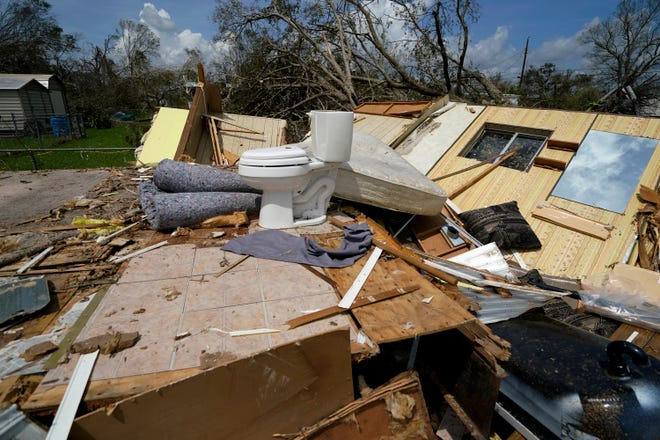 Remnants of the half destroyed mobile home of James Towfley, who is living in the standing half, are seen in Lake Charles in the aftermath of Hurricane Laura Aug. 30.