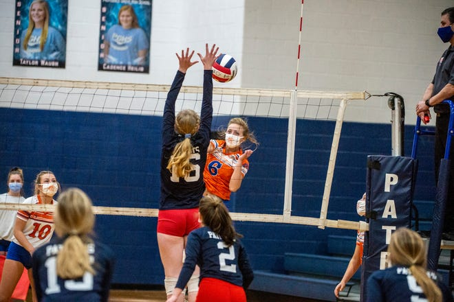 Randleman's Chloe Dixon spikes the ball against Providence Grove's Aleah Batten in PAC-7 action at Providence Grove high School on Tuesday. (PJ Ward-Brown/PJ Ward-Brown Photography)